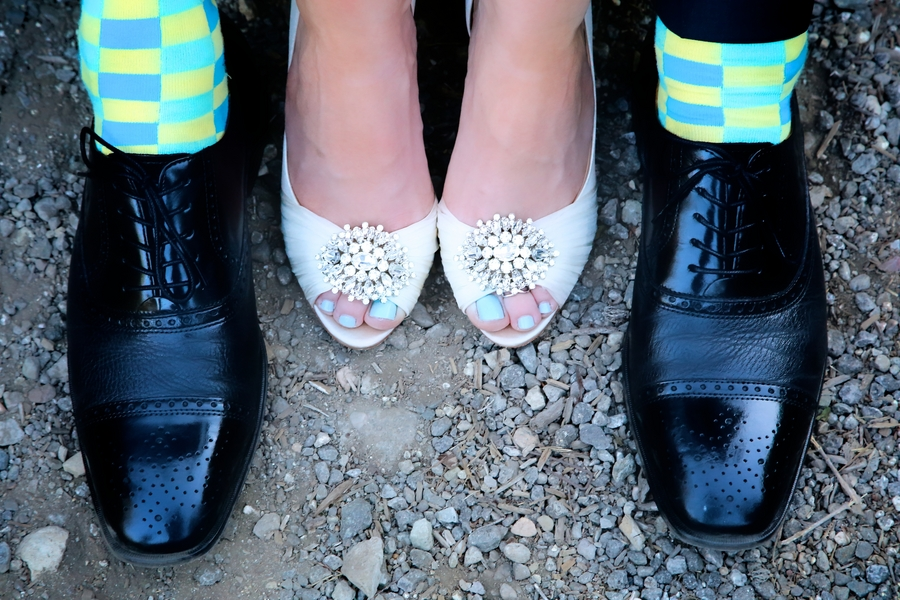 Fun Wedding Photo of the Bride and Groom Wedding Shoes / photo by sun-dance photography