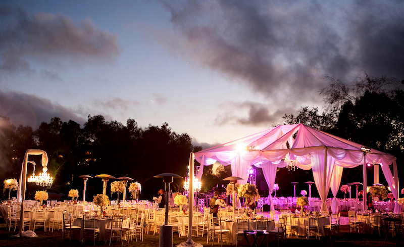 Wedding Reception Idea : pop-up tent under the stars, illuminated with hanging chandeliers / from Anoush Banquet Halls & Catering in CA