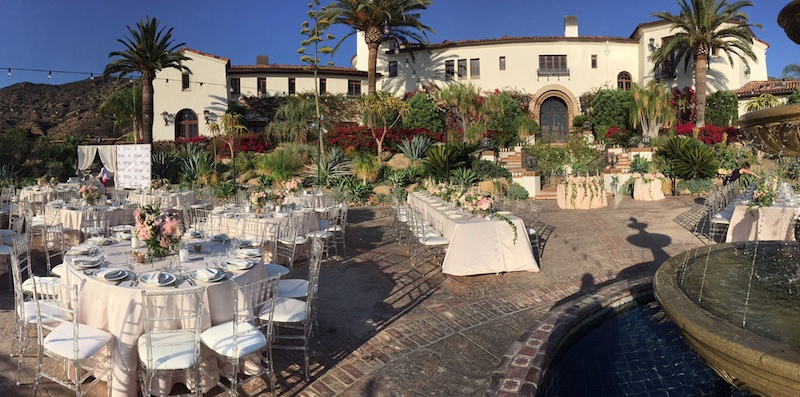 Wedding Reception Idea : dine outside with elegant table settings, a fountain + hanging lights / from Anoush Banquet Halls & Catering in CA