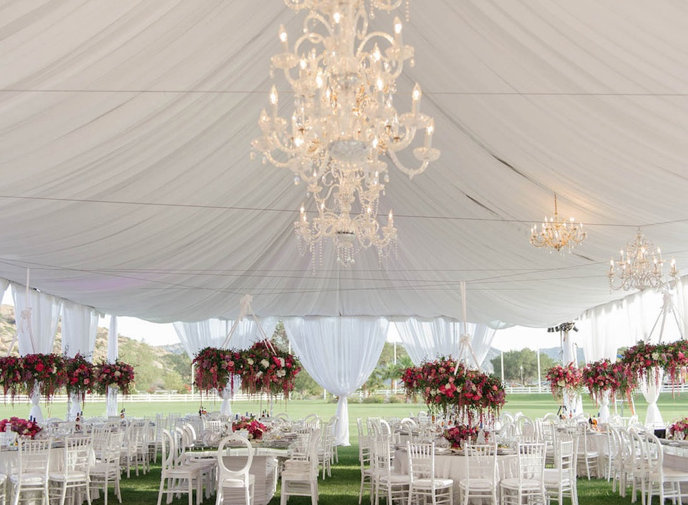 Wedding Reception Idea : go all white with a tent, linens, chairs + chandeliers. Make it pop with bright florals. / from Anoush Banquet Halls & Catering in CA