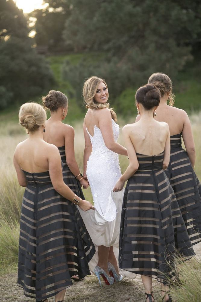 Striped Black and Gold Bridesmaids Dresses / photo by Blumenthal Photography