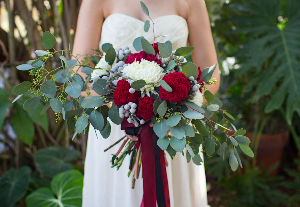 Floral Inspired Bridal Shoot : handmade wedding bouquet with seeded eucalyptus, berzillia brunia, coxcomb, football mums, and a few red carnations wired together to look like peonies / by Spark Photography