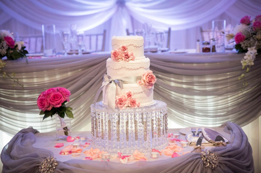 Stunning Wedding Cake Display with Crystals on Cake Stand {from 5 Reasons Why Hiring Professional Wedding Photographers + Videographers is Necessary} / image credit: Focus Productions in Toronto Canada