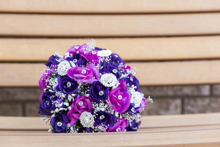 Pretty Purple Wedding Bouquet with Crystals and Brooches {from 5 Reasons Why Hiring Professional Wedding Photographers + Videographers is Necessary} / image credit: Focus Productions in Toronto Canada