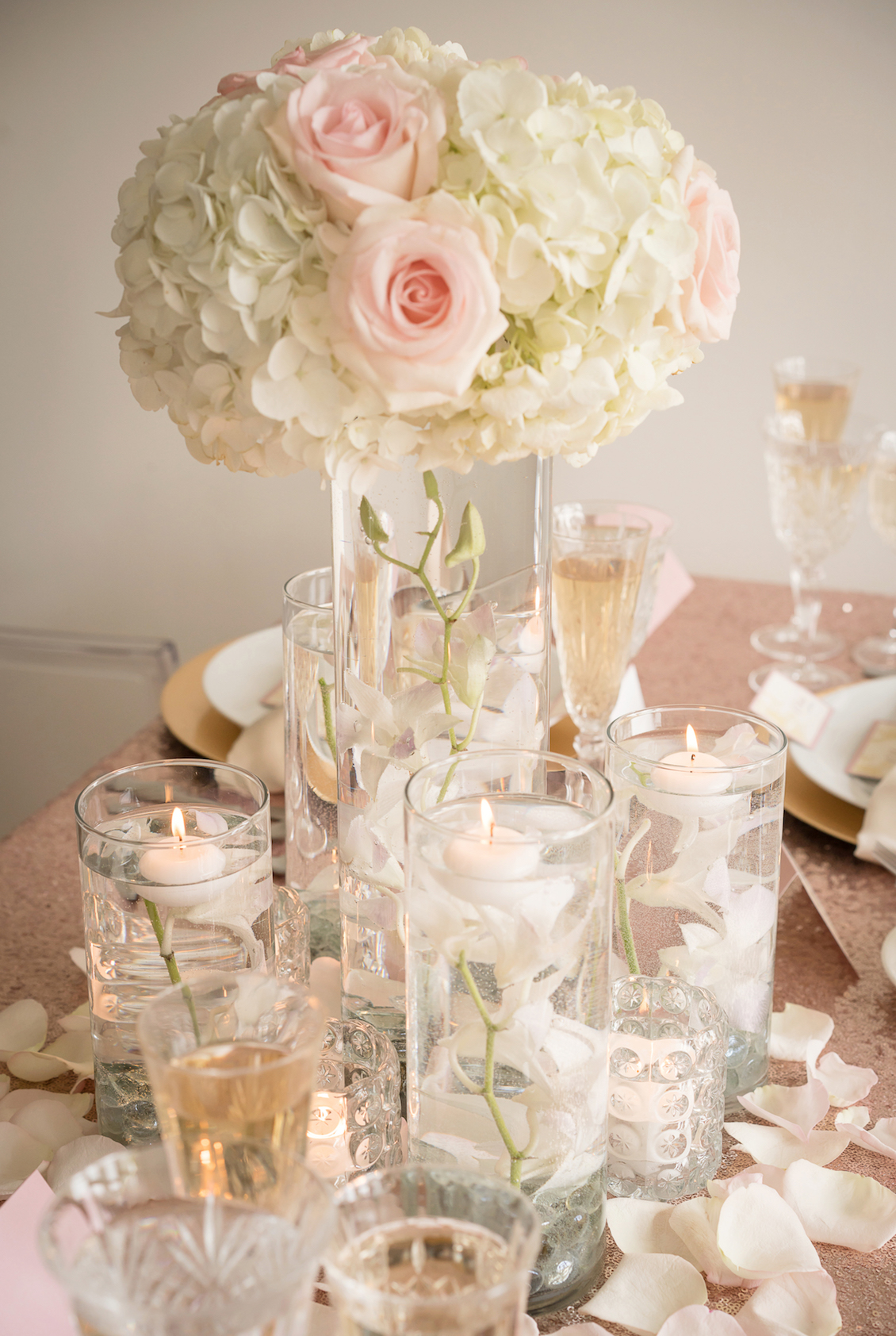 Romantic Wedding Inspiration with flowers floating in Pretty Glass Vases for the Centerpiece / by Madeline Weddings and Events / photo by AMC Studio