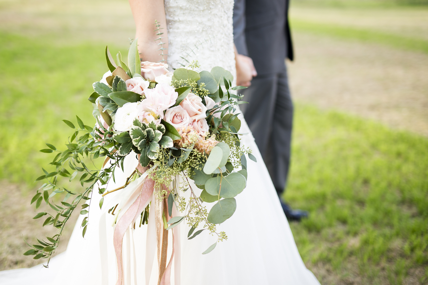 A Gorgeous Peachy Pink Bridal Bouquet with Cascading Greenery / photo by Kevyn Dixon Photo