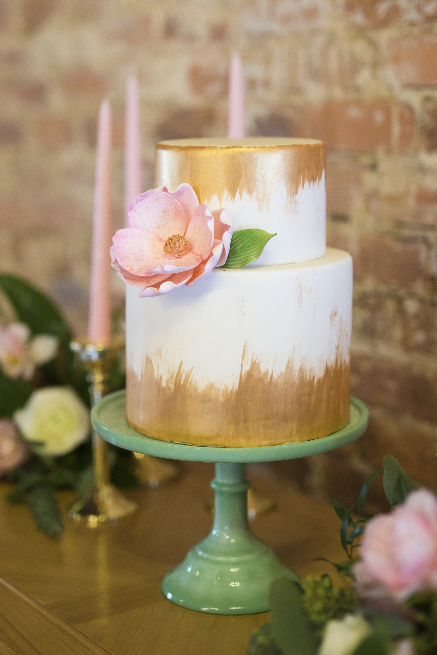 Stunning Wedding Cake with Gold Brushing and a Large Sugar Flower / designed by Ella's Celestial Cake / photo by Kevyn Dixon Photo