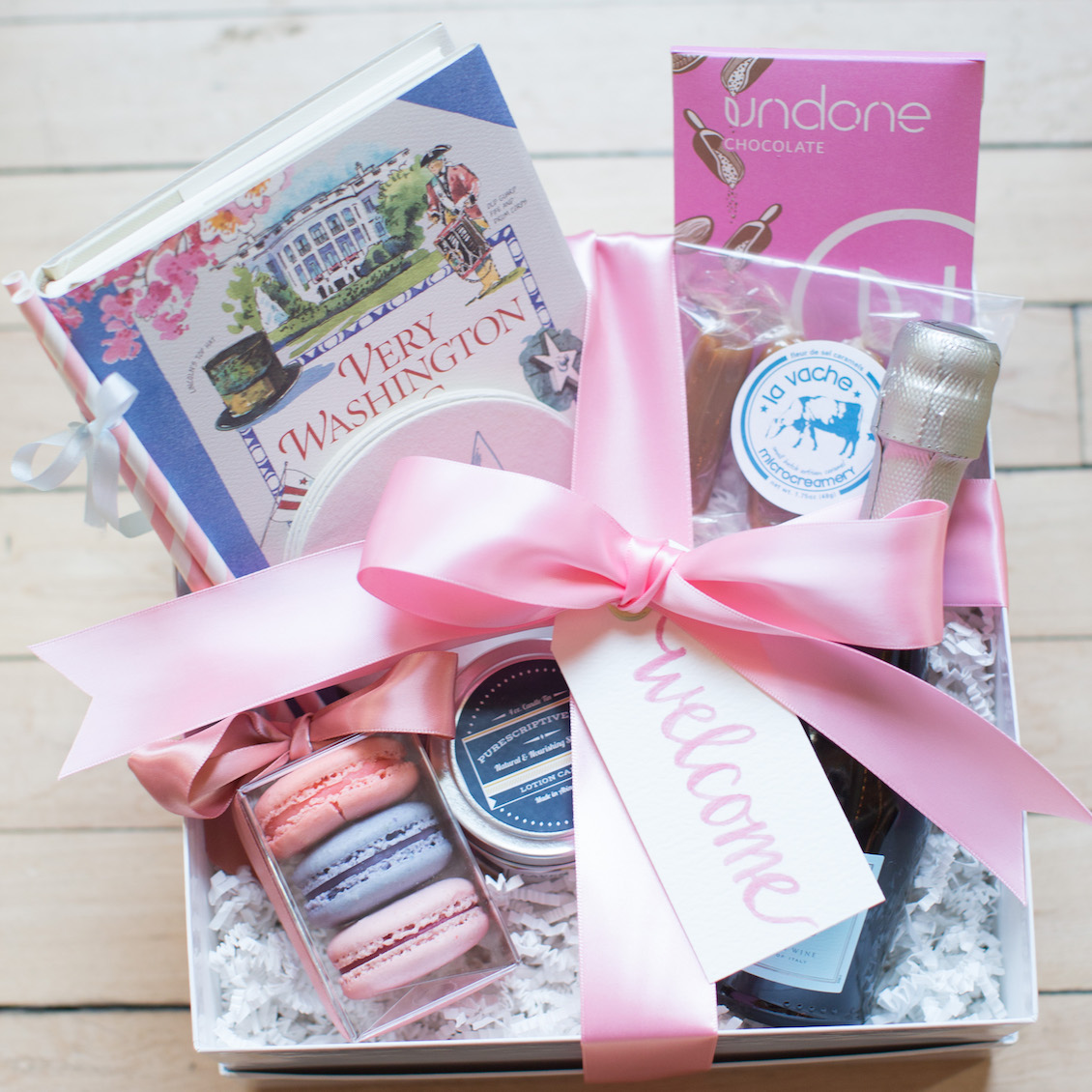 Surprise your Guests with a Wedding Welcome Basket filled with favorites from Local Small Businesses / Photography by Amy Nicole