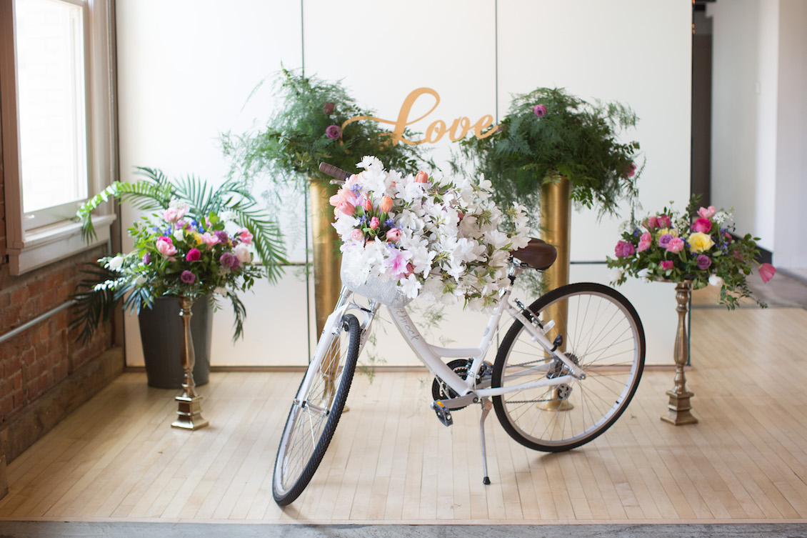 Perfect Wedding Decoration : a bike decorated with lush flowers / from an Urban Glam Meets Modern City Wedding / Florals by EightTreeStreet / Photography by Amy Nicole