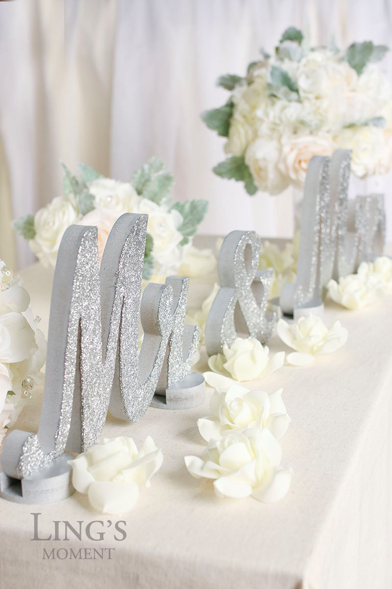 Glittered Mr and Mrs Wedding Table Decoration / from 14 Ways Real Brides Plan to Sparkle on their Wedding Day