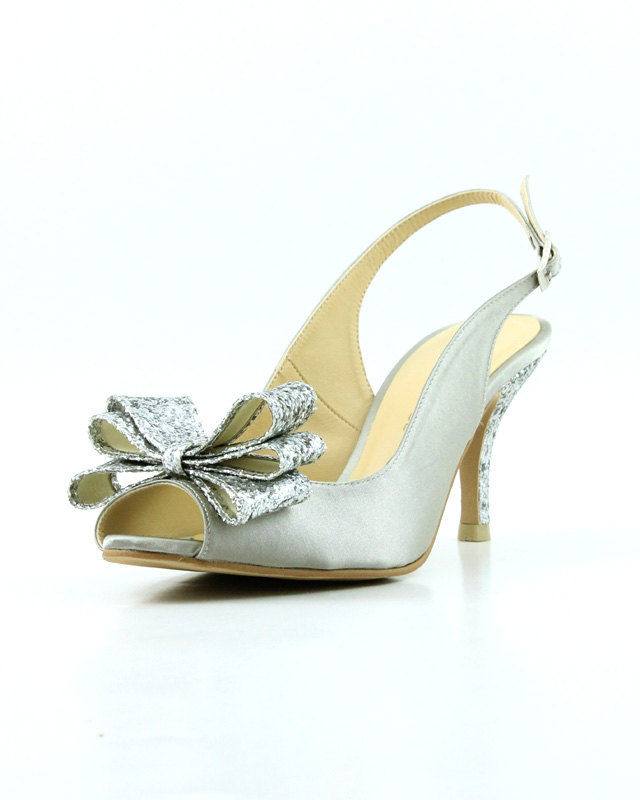 Glittered Silver Wedding Shoe with a Sparkly Bow / from 14 Ways Real Brides Plan to Sparkle on their Wedding Day