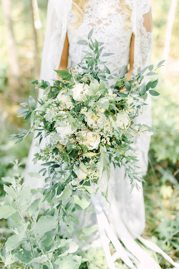 Gorgeous lush blooms created the perfect Boho Styled Cascading Bridal Bouquet - photo by Destination Wedding Photographer Linda-Pauline Pehrsdotter in Sweden