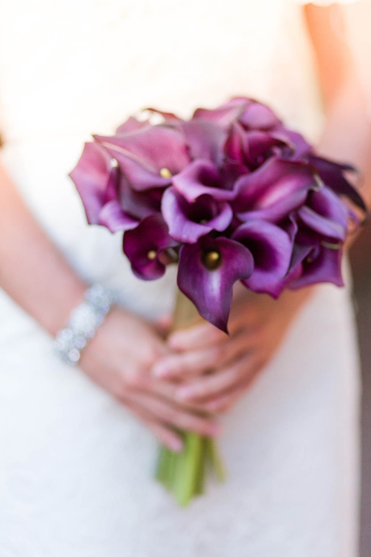 A gorgeous purple calla lily bridal bouquet / from a Washington DC Military Elopement Wedding / photo by Marianne Blackham Photography
