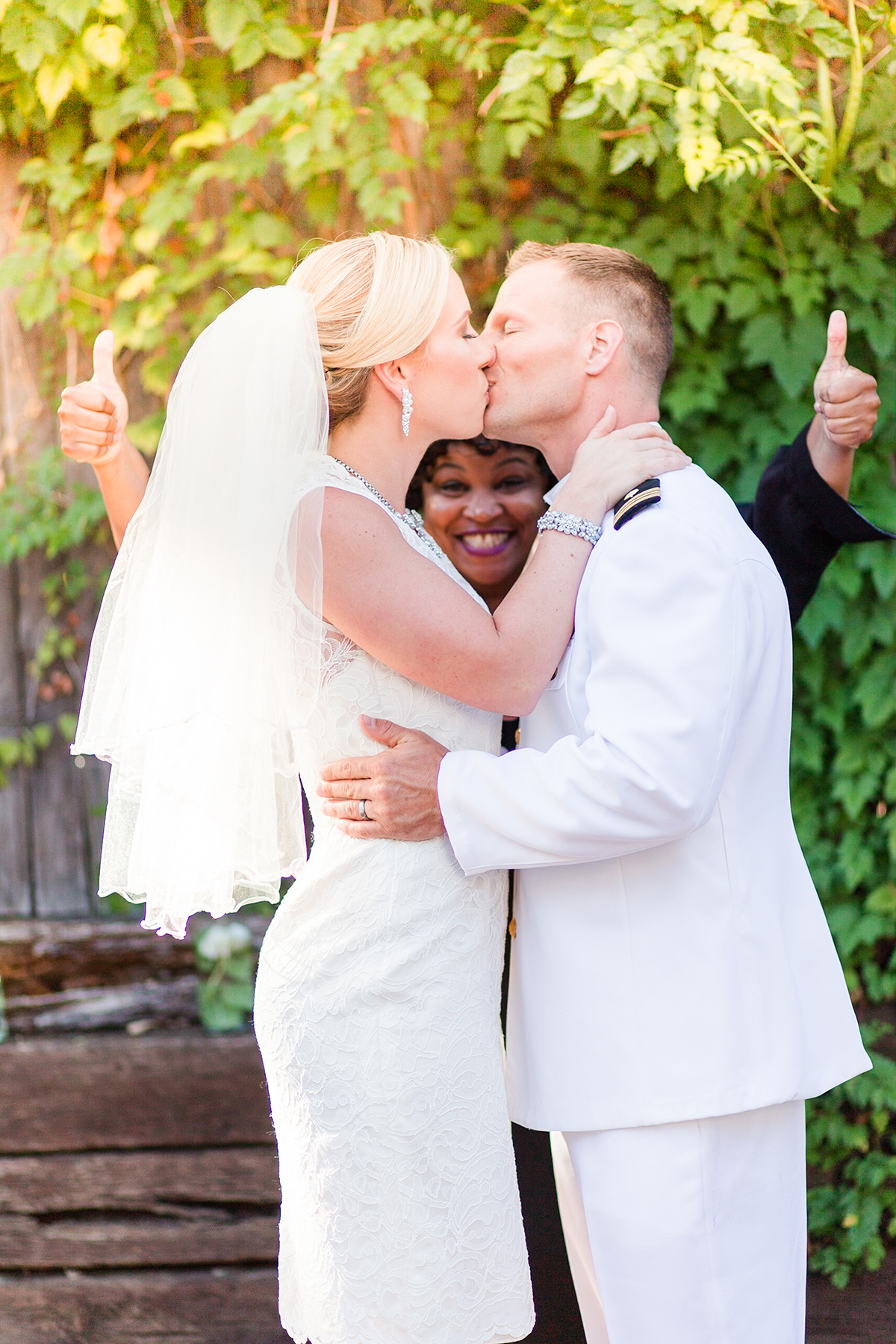 Super cute photo of the bride and groom after saying I Do - love how the officiant is framed below their kiss / from a Washington DC Military Elopement Wedding / photo by Marianne Blackham Photography