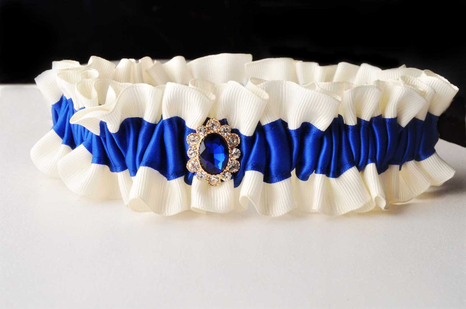 Handmade Royal Blue Wedding Garter with a blue rhinestone - details for blue weddings - handmade bridal accessories from Knotted and Bent - see more on www.brendasweddingblog.com