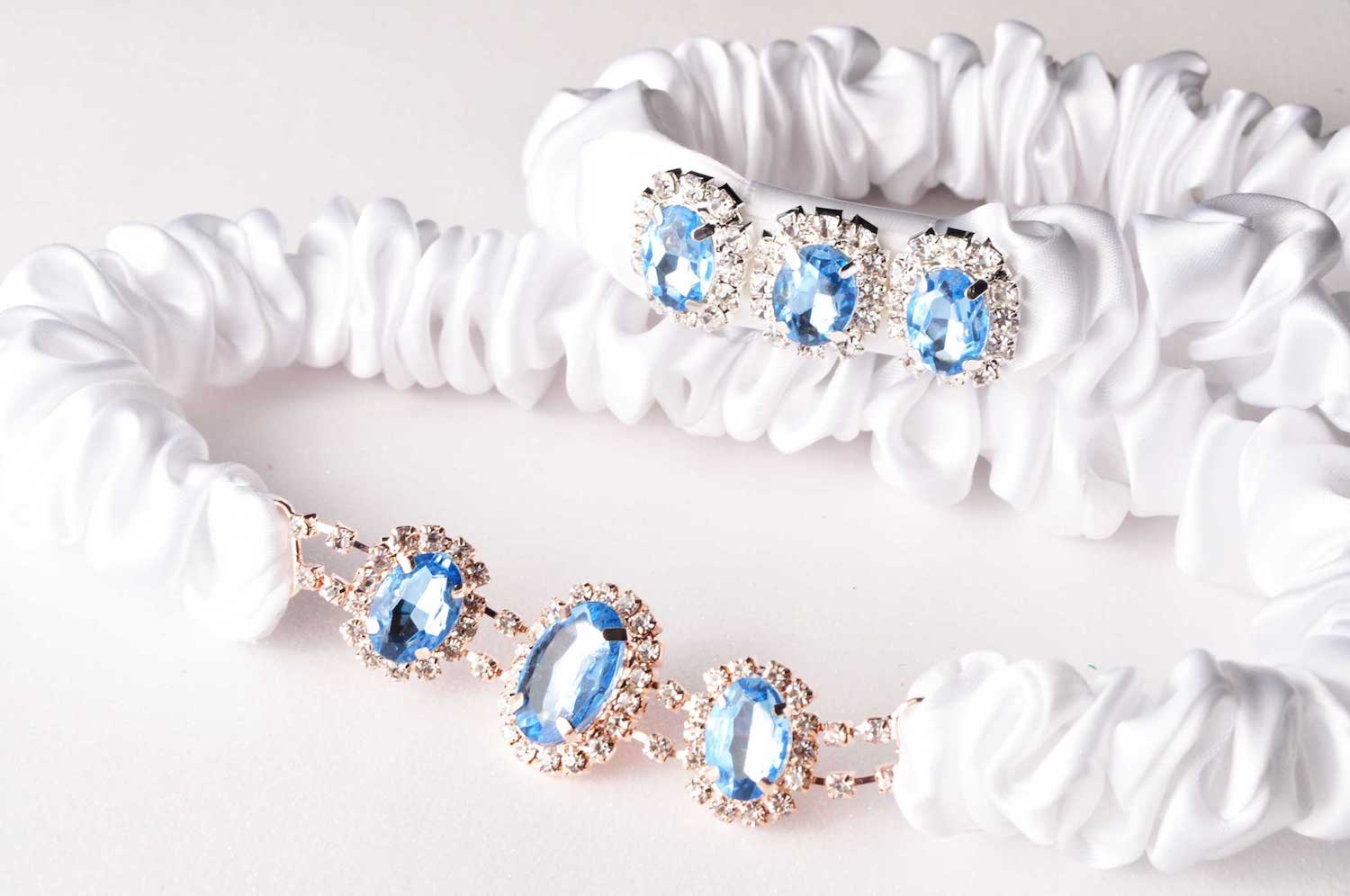 Handmade Something Blue Wedding Garter with a light blue shimmer rhinestones and dainty diamante - details for blue weddings - handmade bridal accessories from Knotted and Bent - see more on www.brendasweddingblog.com