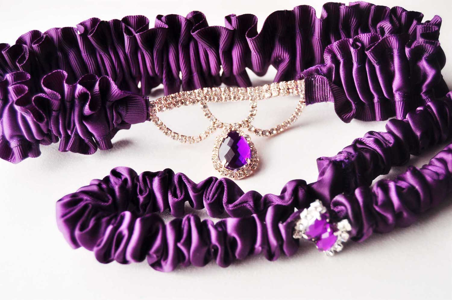 Handmade Purple Wedding Garter with a Rose Gold and Rhinestone teardrop connector - details for purple weddings - handmade purple bridal accessories from Knotted and Bent - see more on www.brendasweddingblog.com