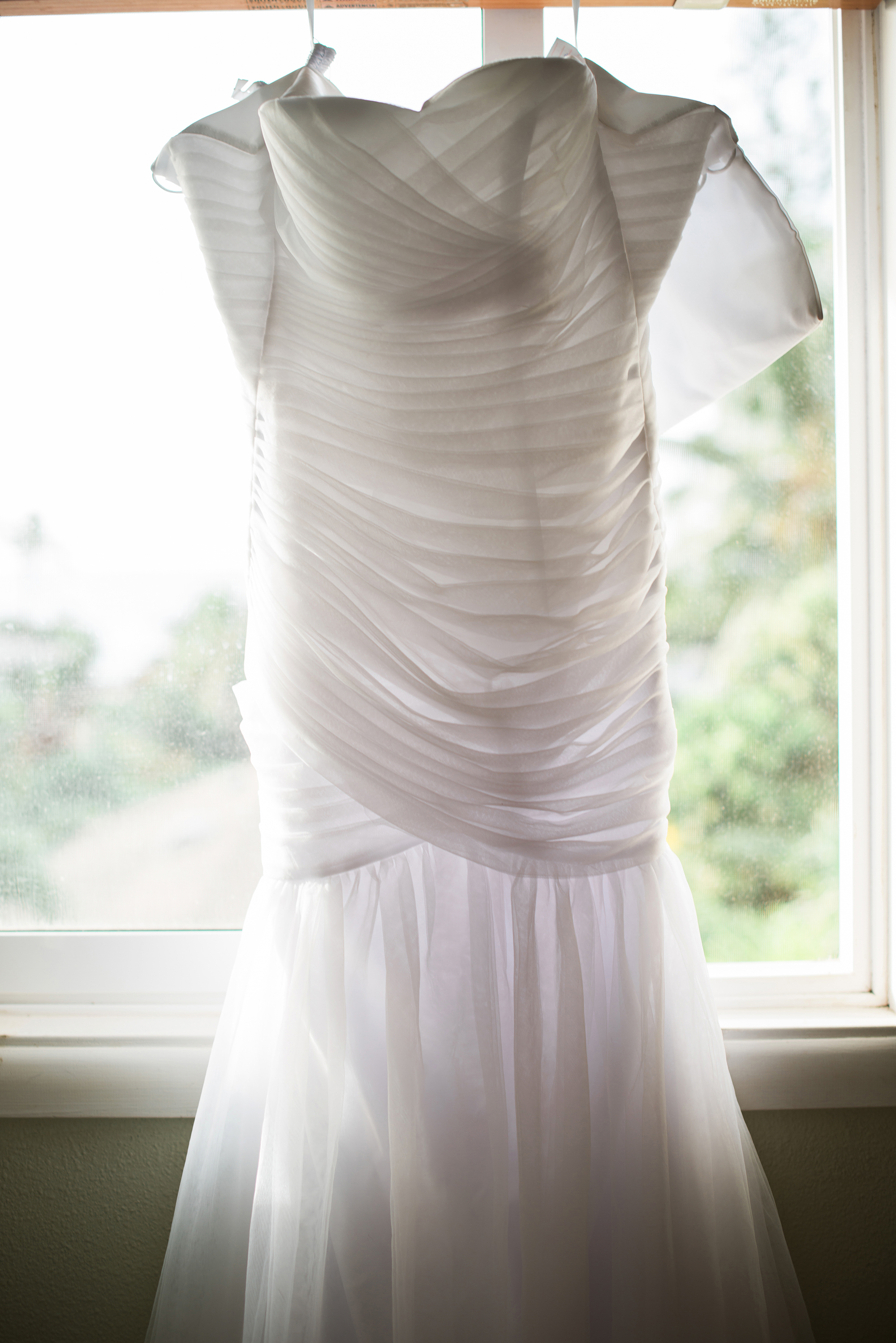 Wedding Dress Photo with light reflecting off the pleating / by Marianne Blackham Photography - a Washington DC based natural light wedding photographer / as seen on www.BrendasWeddingBlog.com