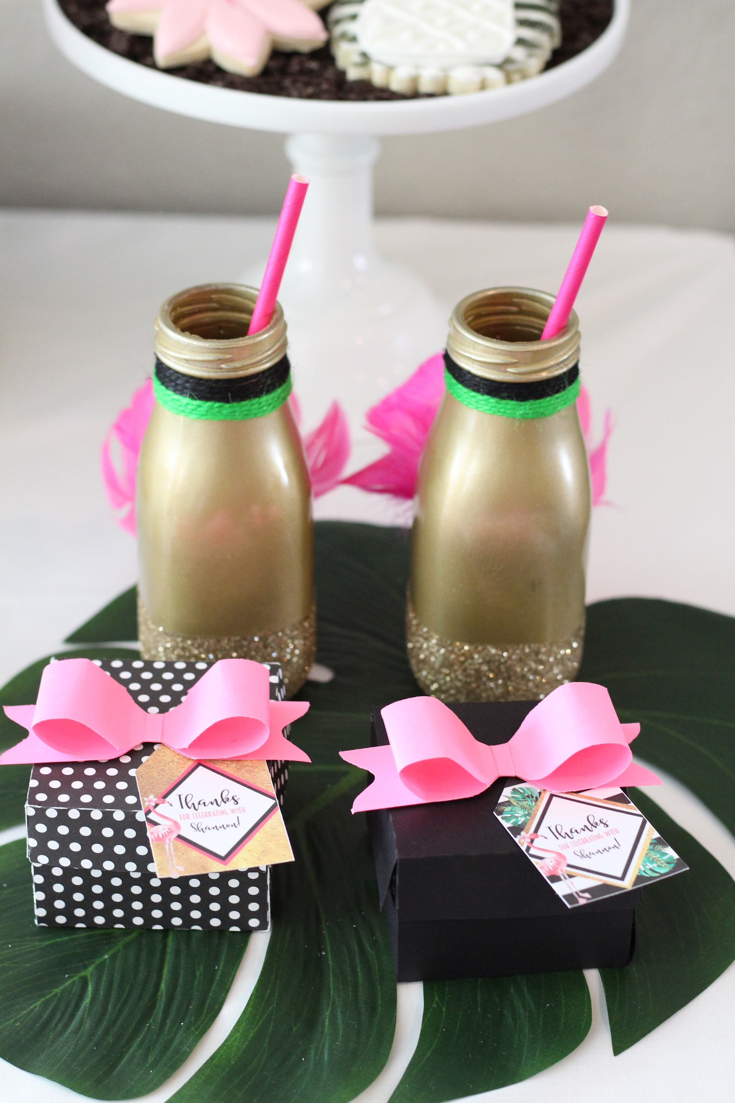 Party Inspiration for a Let's Flamingo Bachelorette Party or Bridal Shower - a fun flamingo party theme in pink, white, black, green and gold. Gold Painted Glasses with Feathers. As seen on www.BrendasWeddingBlog.com
