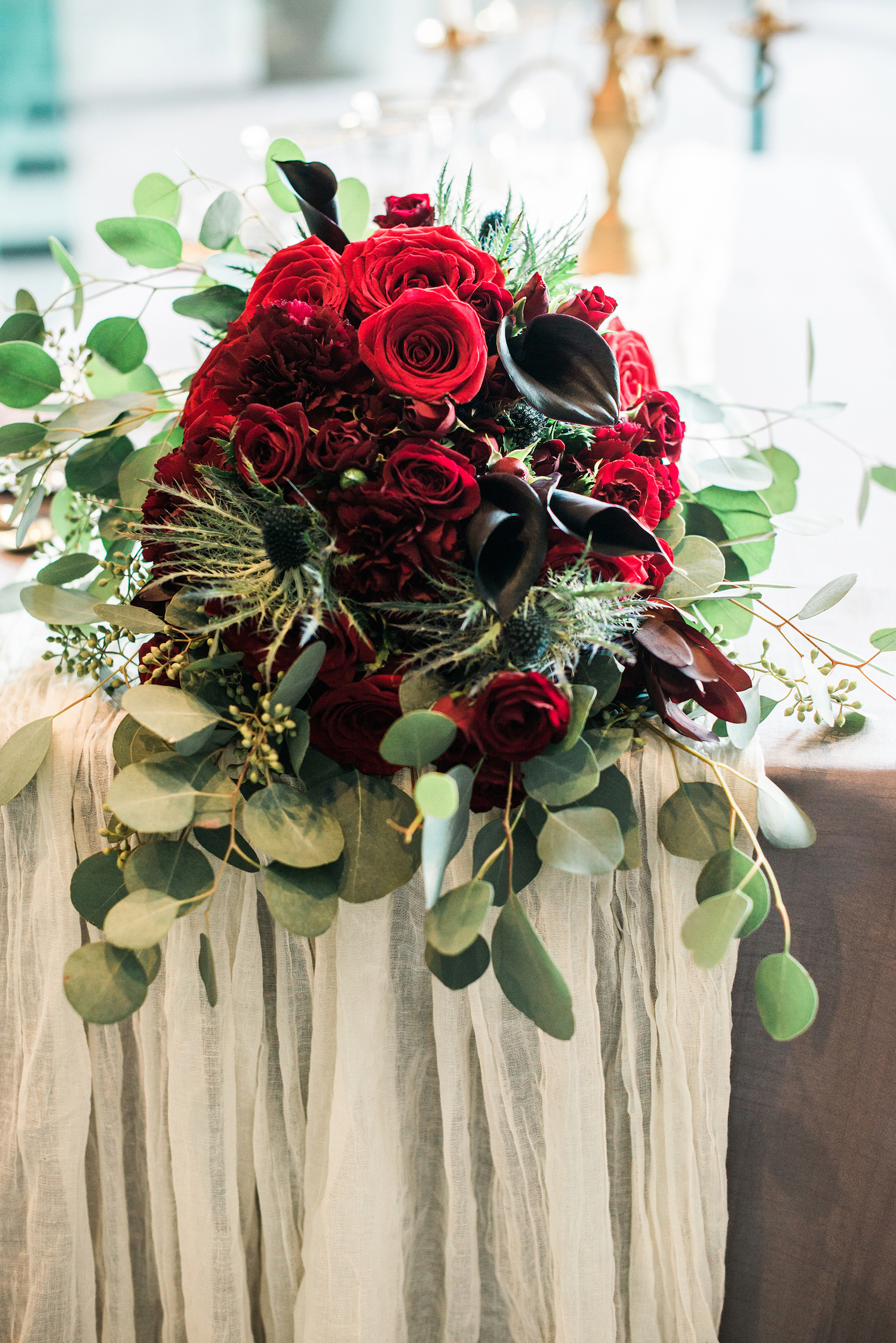Gorgeous Red Roses and Carnations with Thistle Centerpiece — luxurious and romantic vintage wedding inspiration — photo by Marianne Blackham Photography — as seen on www.BrendasWeddingBlog.com