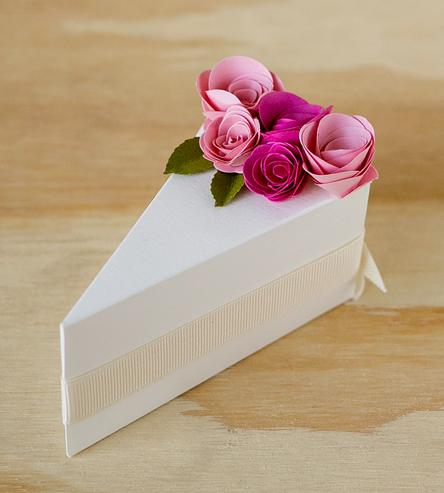 Cream Wedding Cake Favor Boxes — Send your wedding guests home with a slice of wedding cake in a favor box shaped like a cake slice — as seen on www.BrendasWeddingBlog.com