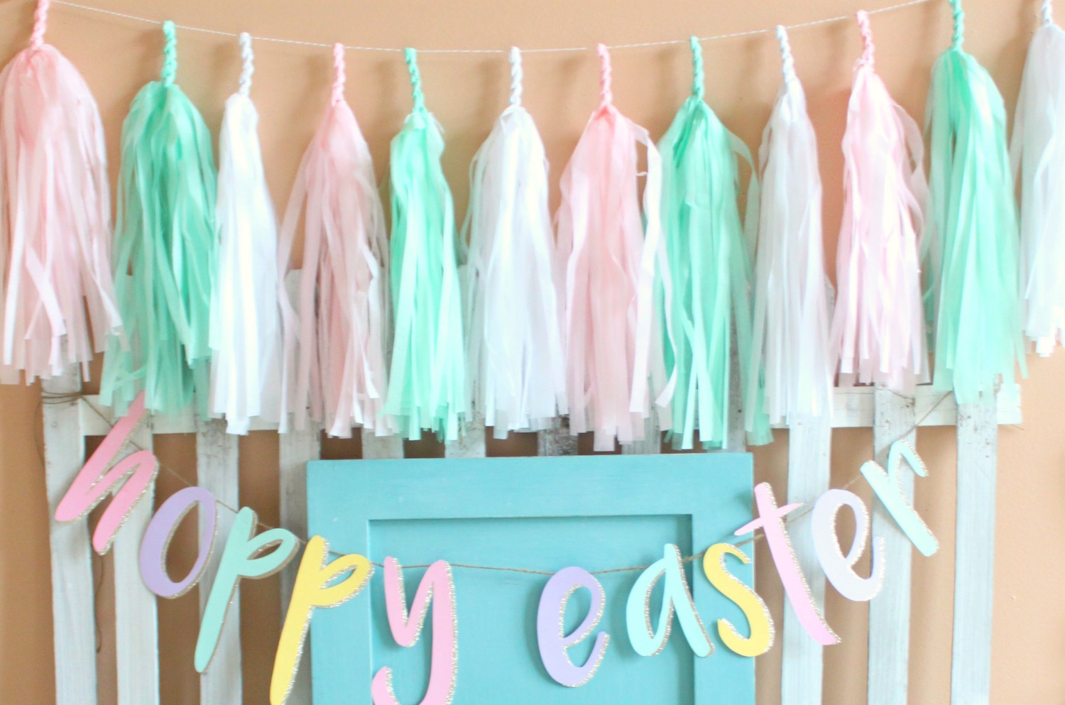 Tassel Garland in the perfect spring colors for bridal shower decor — Click to see 37 Creative DIY Wedding Ideas for Spring — as seen on www.BrendasWeddingBlog.com