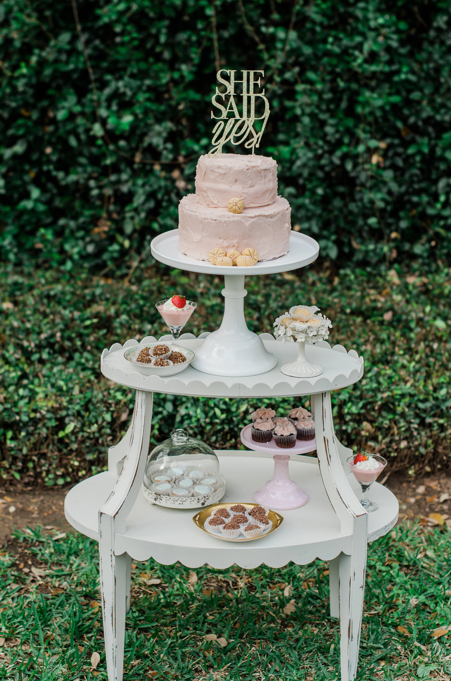 Super sweet dessert station with tiers and a cake with a She Said Yes Gold Lettered Cake Topper — Click to see 8 DIY Wedding Ideas for a Springtime Bridal Shower Brunch — Part of the 37 Creative DIY Wedding Ideas for Spring as seen on www.BrendasWeddingBlog.com