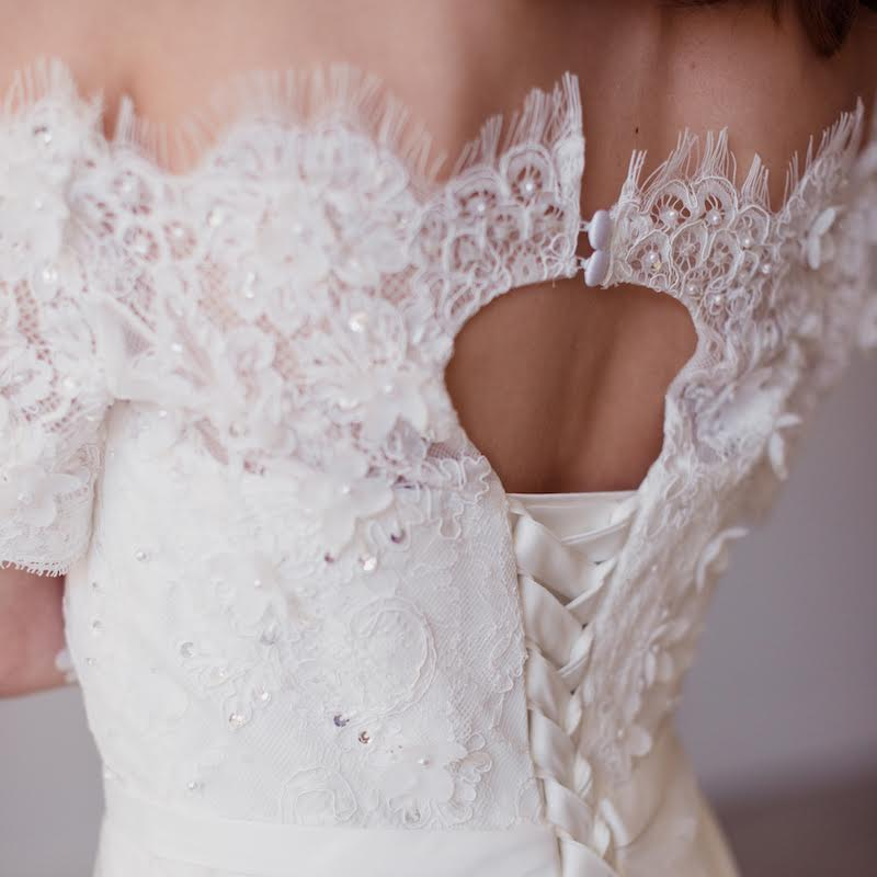 Romance is in the air with this lovely off the shoulder Lyra Vega wedding gown. Embellished with beading and lace appliques, this vintage inspired beauty is finished with scalloped lace trim at the hem and neckline. Perfectly delicate and luxurious for the modern day princess. As seen on www.BrendasWeddingBlog.com