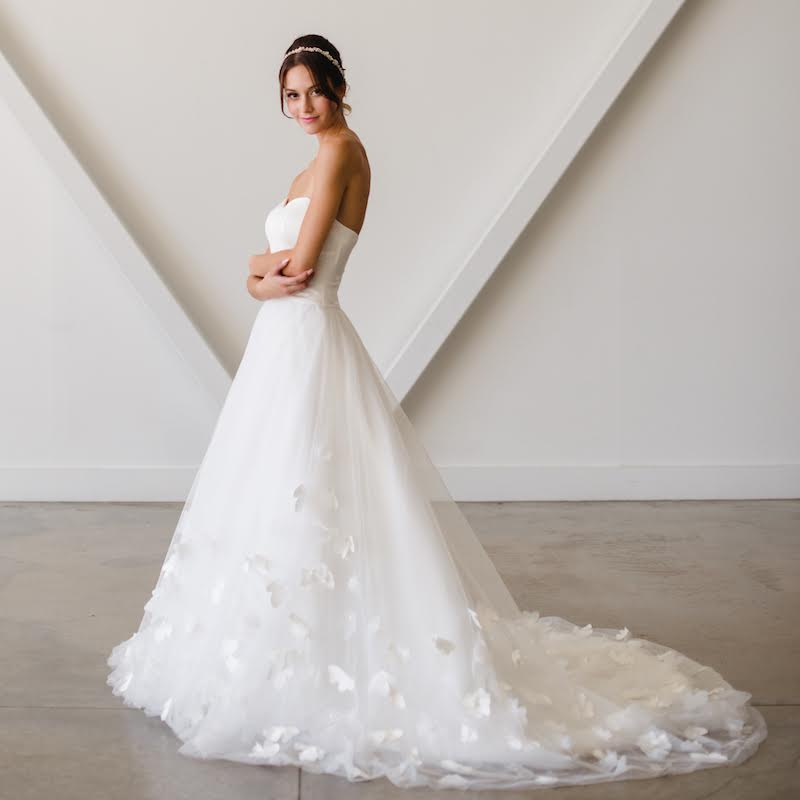 Timeless wedding gowns for the modern bride - created by Lyra Vega Bridal. A handpicked collection of collection of bridal gowns that focus on principles of timeless design, lush fabrics, subtle but interesting details, and impeccable fit. As seen on www.BrendasWeddingBlog.com — Lyra design shown here