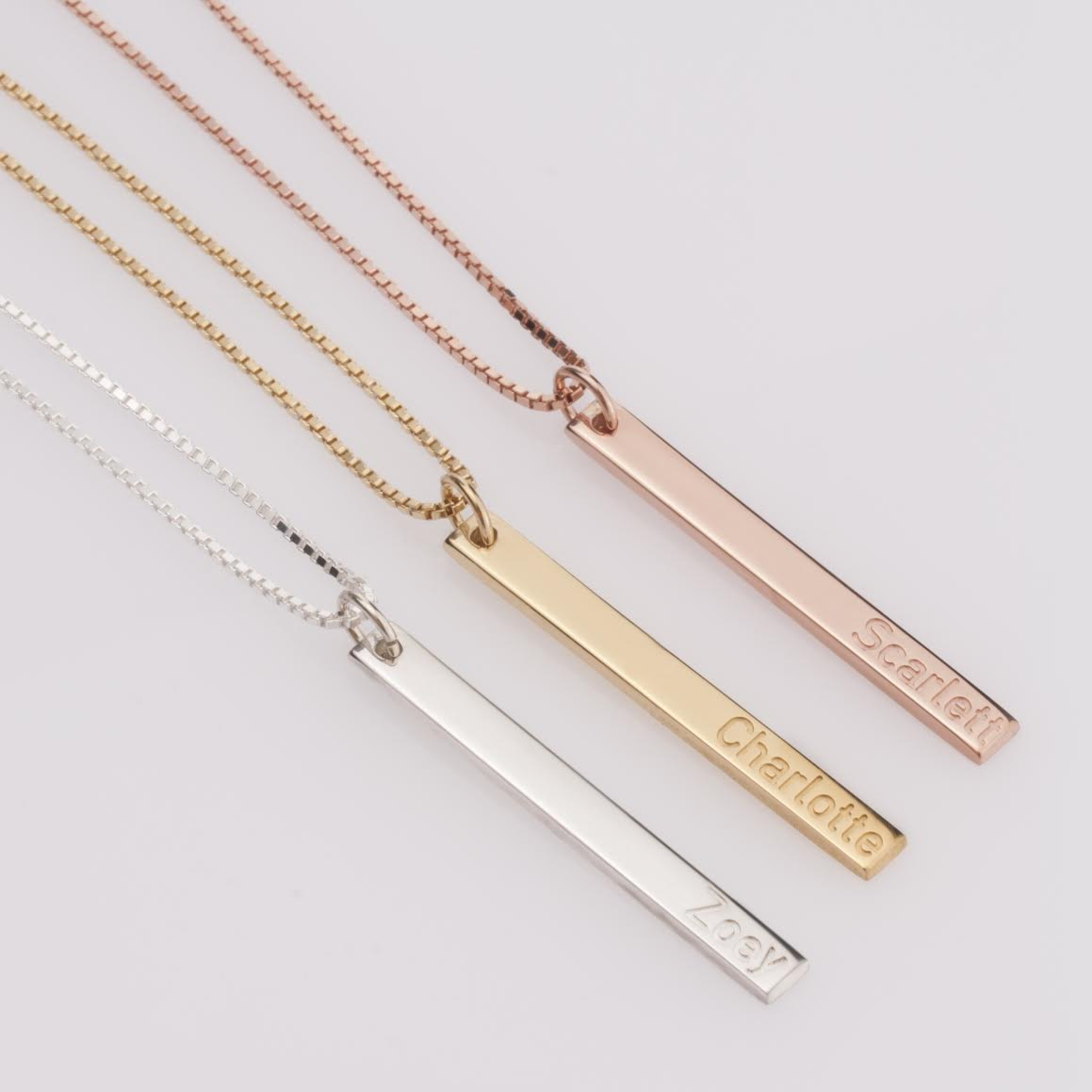 The perfect Bridesmaid Gift : a Dainty Personalized Bar Necklace from oNecklace. It's the most unique pendant featuring an elegant thin bar, with intricately engraved letters and hangs effortlessly from a quality chain. Comes available to personalize in Sterling Silver, 24K Gold Plated, Rose Gold and 14K Gold. See more on www.BrendasWeddingBlog.com