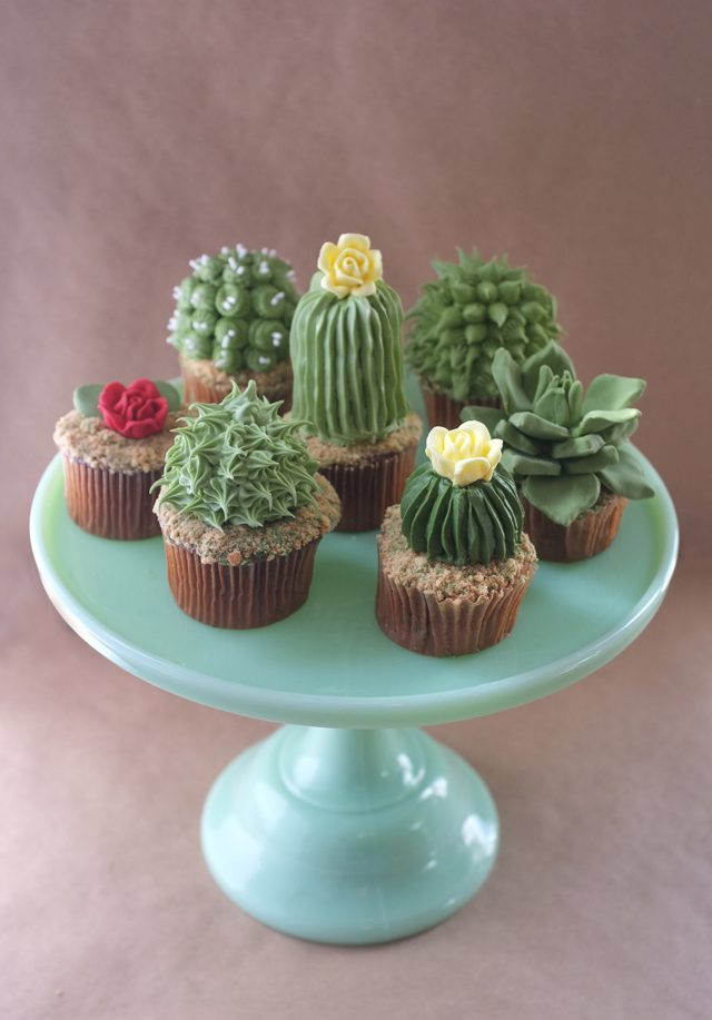 Present cupcakes at your next desert themed dessert party with frosting in the shape of cactus. As seen in Cactus Wedding Ideas - a hot wedding trend on www.BrendasWeddingBlog.com