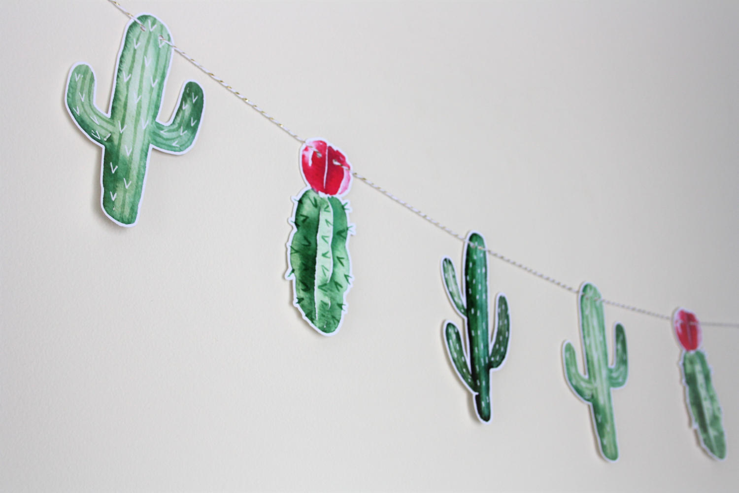 Dress up your dessert table with a cactus garland as the backdrop. As seen in Cactus Wedding Ideas - a hot wedding trend on www.BrendasWeddingBlog.com