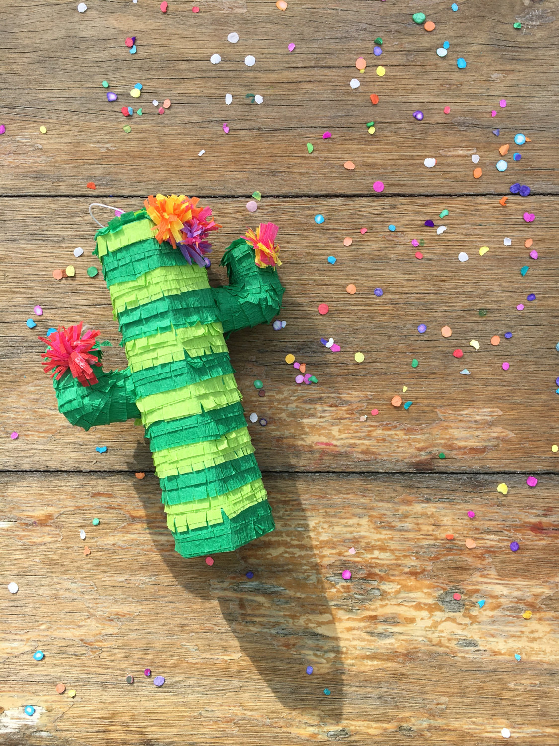 Mini Cactus Pinatas are perfect for place settings or centerpieces to hold the table number. As seen in Cactus Wedding Ideas - a hot wedding trend on www.BrendasWeddingBlog.com