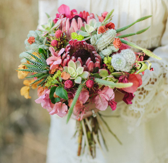 Planning a desert or rustic wedding? Consider a bridal bouquet with cactus and succulents tucked inside. As seen in Cactus Wedding Ideas - a hot wedding trend on www.BrendasWeddingBlog.com