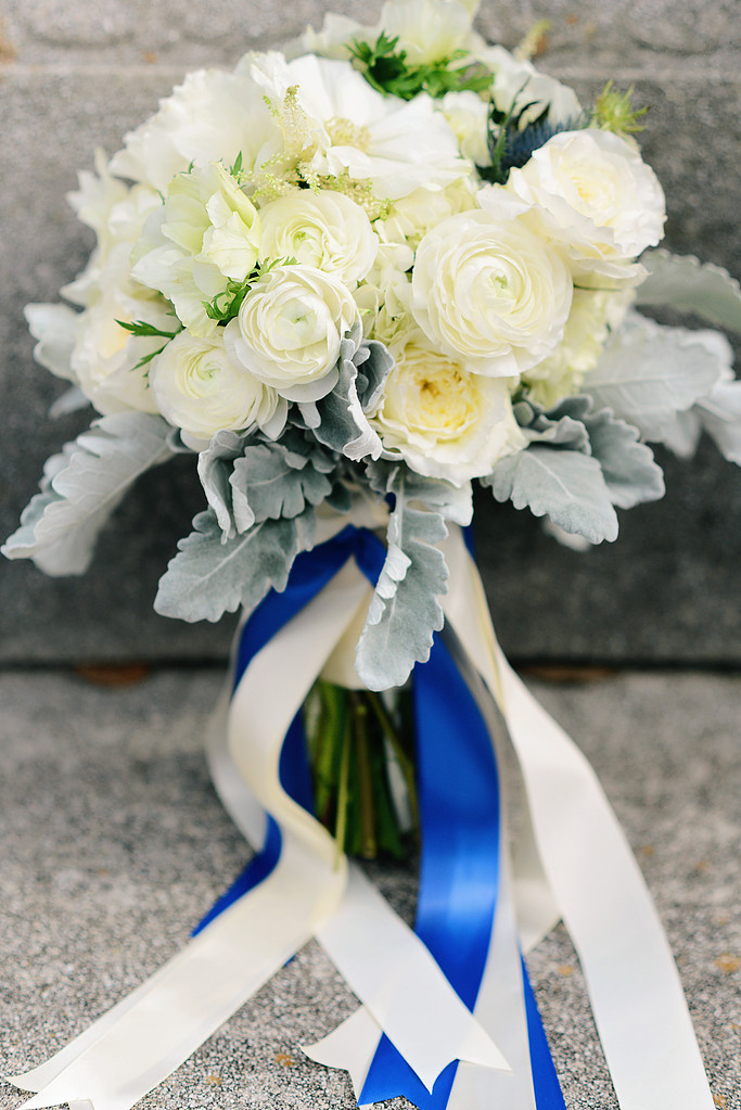 Gorgeous white ranunculus wedding bouquet with cream and blue ribbons - designed by EightTreeStreet Floral - wedding floral designer in Washington DC Maryland - as seen on www.brendasweddingblog.com
