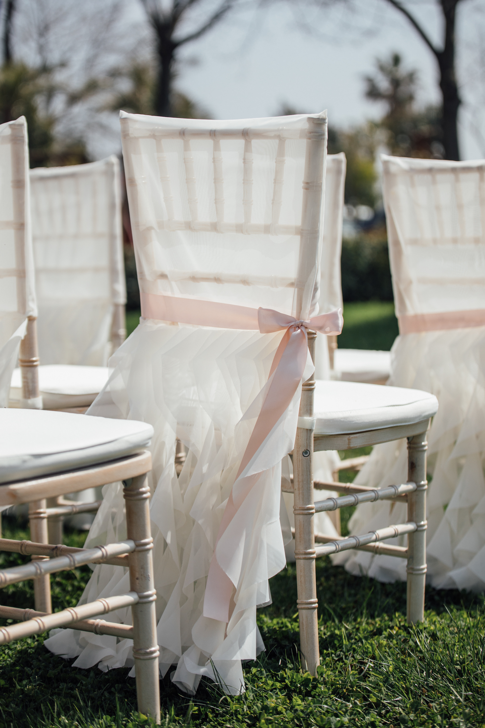 Pretty ruffled chair covers tied with ribbon from a Lemon Yellow Garden Wedding Styled Shoot in Rome Italy - by Jess Palatucci Photography - as seen on www.BrendasWeddingBlog.com