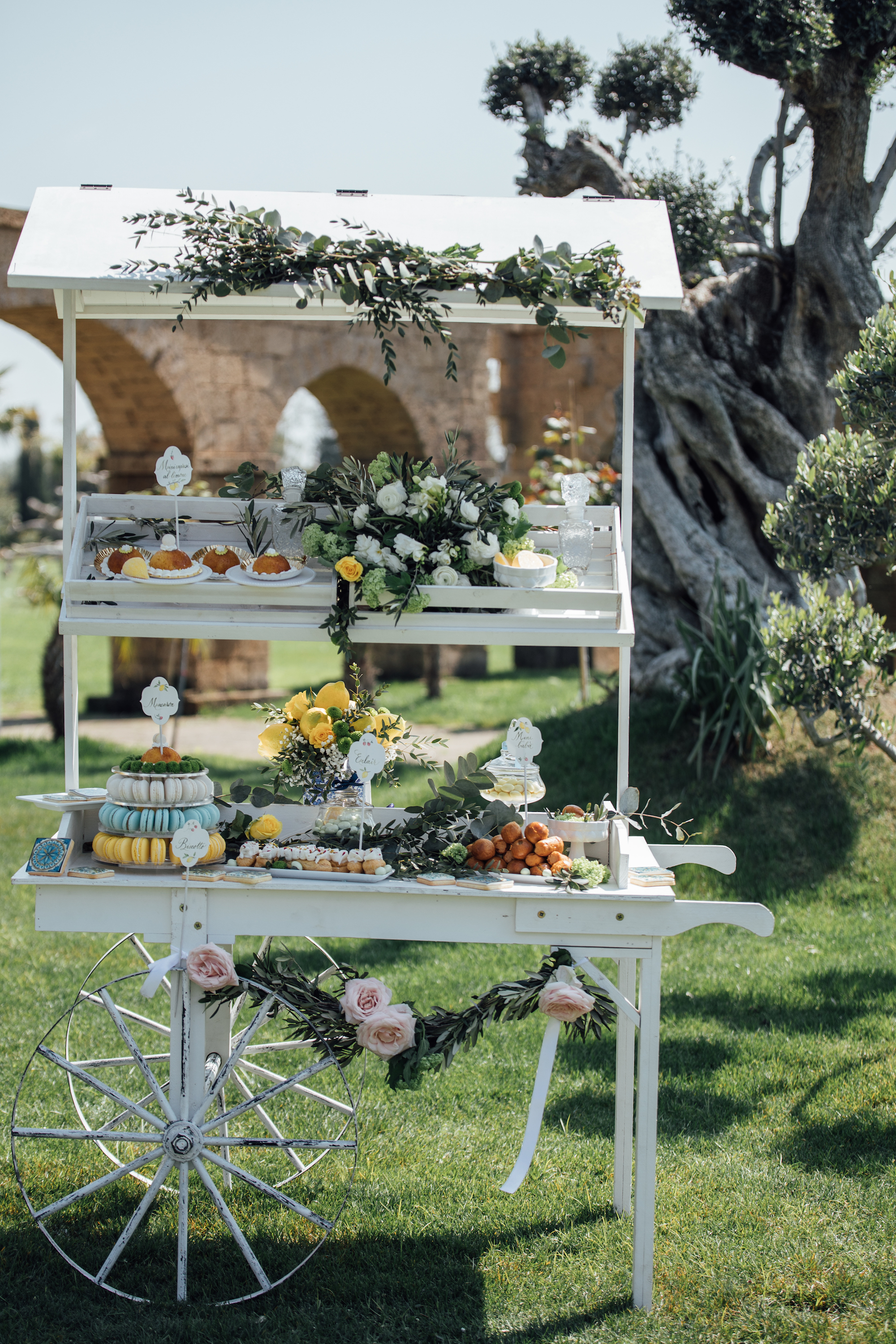 Italian Wedding sweets displayed on a bar cart - from a Lemon Yellow Garden Wedding Styled Shoot in Rome Italy - by Jess Palatucci Photography - as seen on www.BrendasWeddingBlog.com