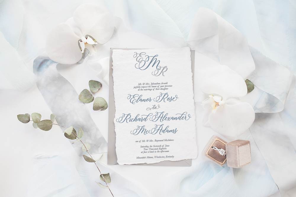 Custom Wedding Invitation with a Script Monogram and Deckled Edge / from Simply Paper where they help brides and grooms Celebrate their special moments in life through paper / as seen on www.BrendasWeddingBlog.com