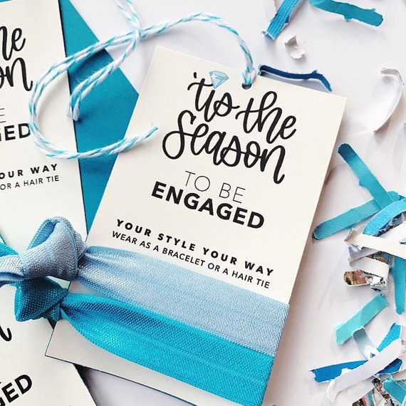 'Tis the Season to be Engaged - these hair tie cards from my @festivefetti #EtsyShop can be used as a gift tag for the Bride to Be's present, tucked into the wedding planner or photographers welcome kit, or even as bridal shower favors. Available as a card or gift tag with twine. Click my profile link to shop for yours today.⠀ -⠀ -⠀ -⠀ -⠀ -⠀ #somethingblue #engagementseason #etsywedding #etsyweddings #instaweddings #smallbusinesslove #partystyle #shophandmade #etsyshopowner #festivefetti #brendasweddingblog #designisinthedetails #sobestfriendsforfrosting #ohwowyes #itshappyhere #eventstylists #makewavesmonday #hairties #hairaccessory #bridestyle #bridestyling #welcomekit #colorgram #bridesmaidsgifts #engagedtothedetails #huffpostlifestyle #gifttags