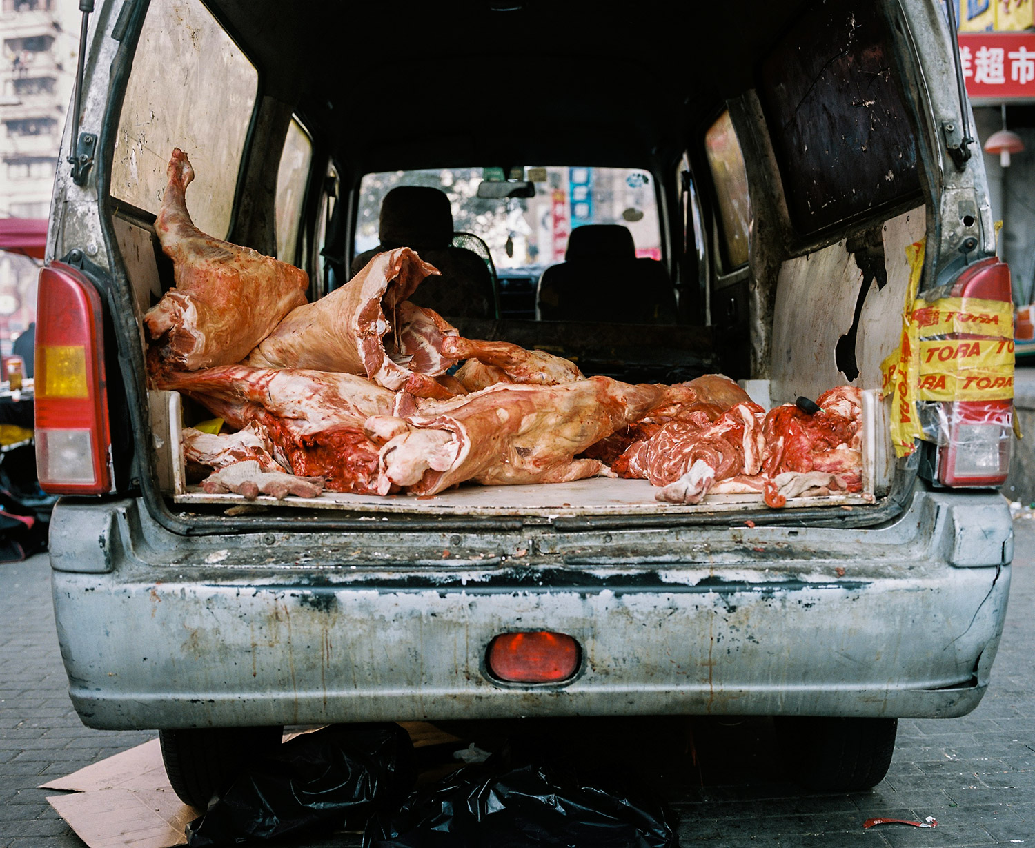 A van loaded with Lamb meat for the friday market near the Shanghai Mosque