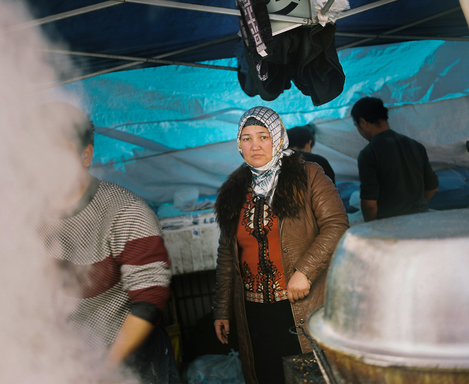 A muslim woman preparing food at the friday market near the Shanghai Mosque