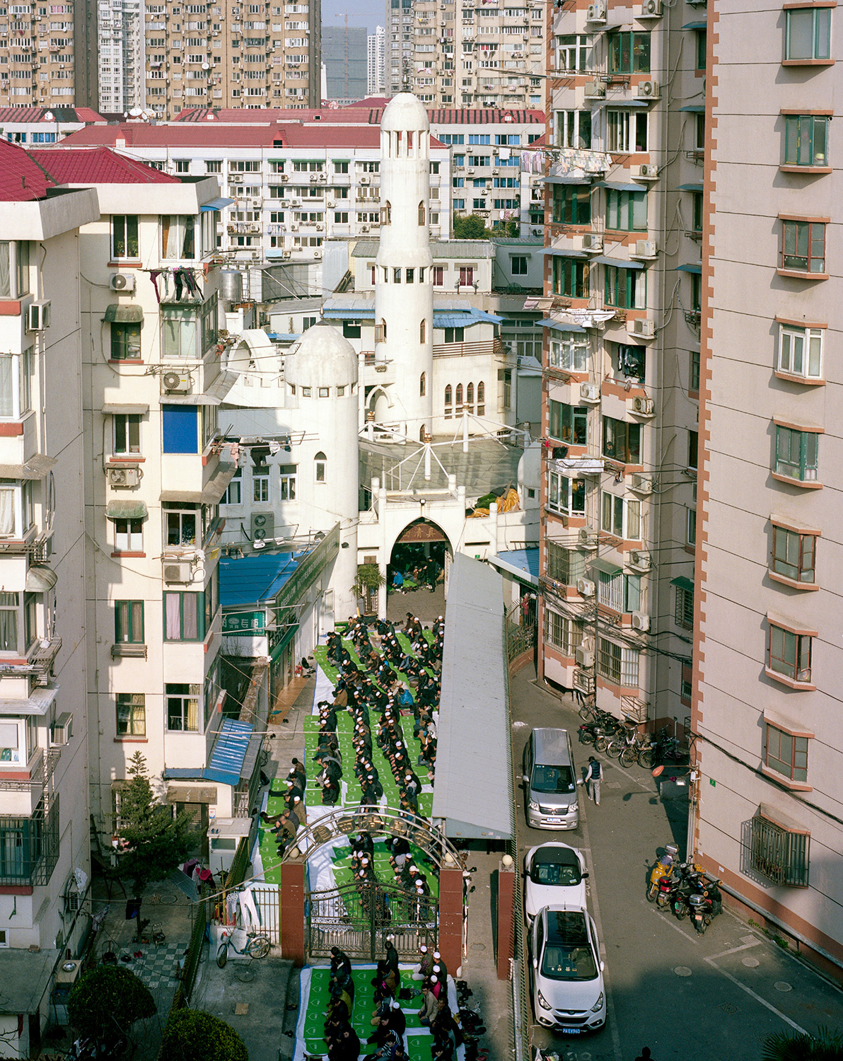 The Shanghai Mosque is located in a residential area surrounded by high rise housing projects making it almost impossible to see it from the street. The place itself is too small to welcome the thousands who come to the friday prayers.