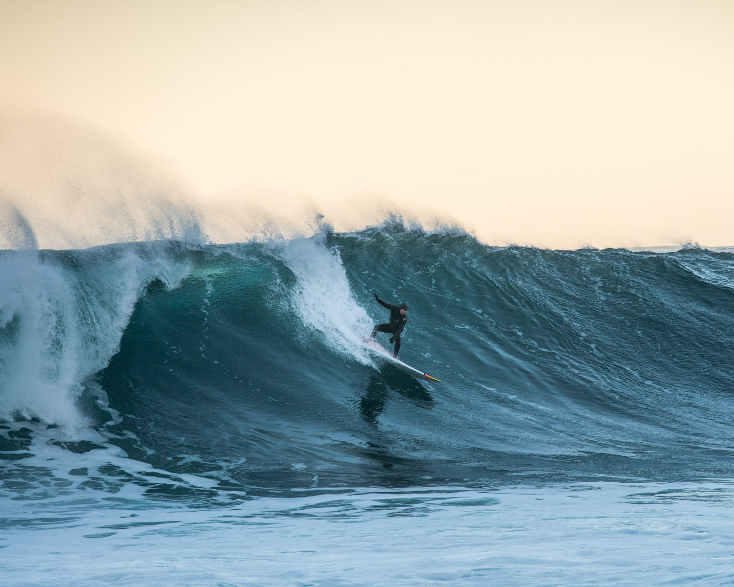 A local Lofoten based teacher enjoy the big swell coming from Iceland to spend an afternoon surfing in Unstad