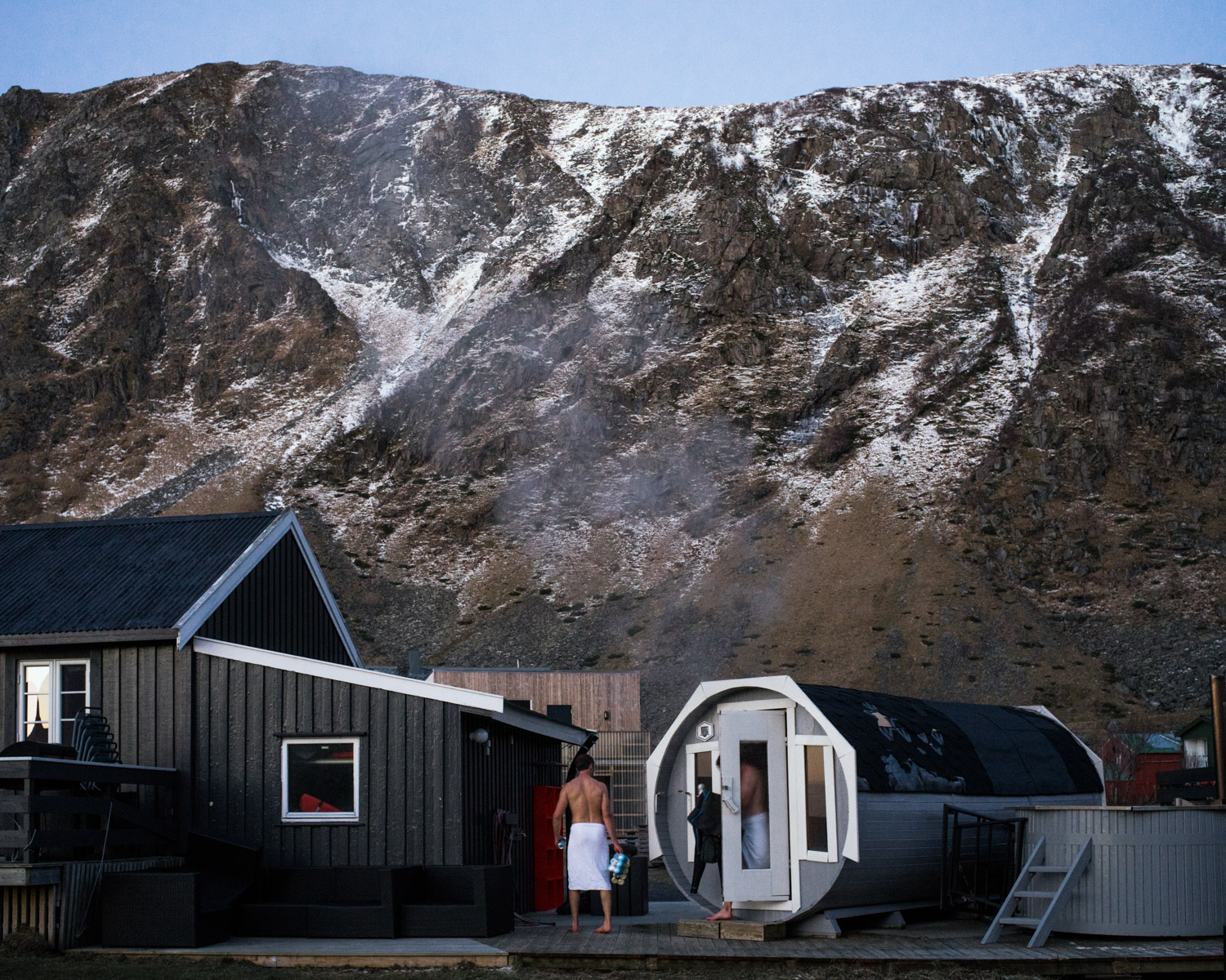 A couple of surfers finished a sauna session at the end of a long day surfing in the icy water of the lofoten islands in the Unstad Camp