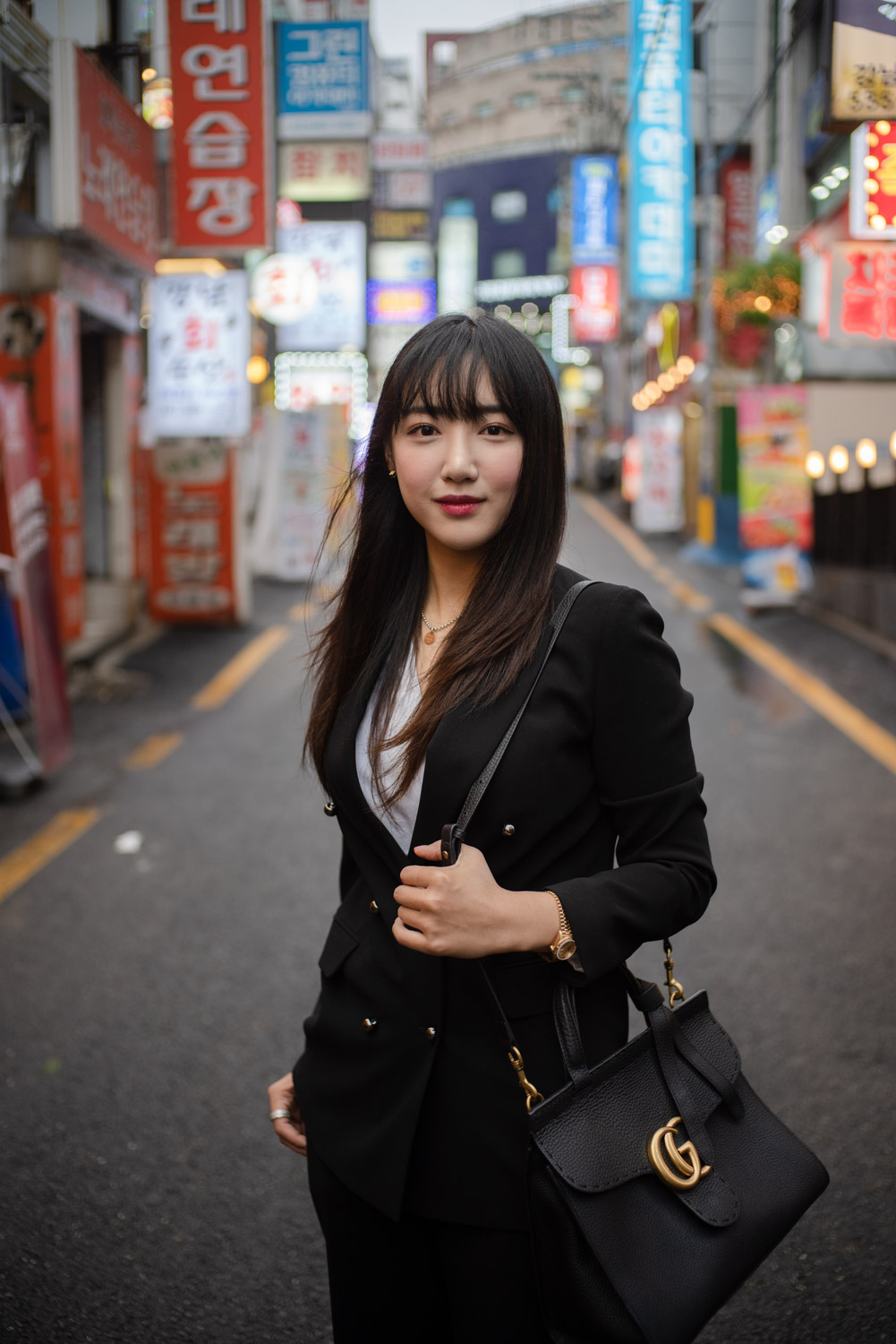 Sara Kim posing in a backstreet of the Gangnam district in Seoul. Tim Franco for the New York Times.