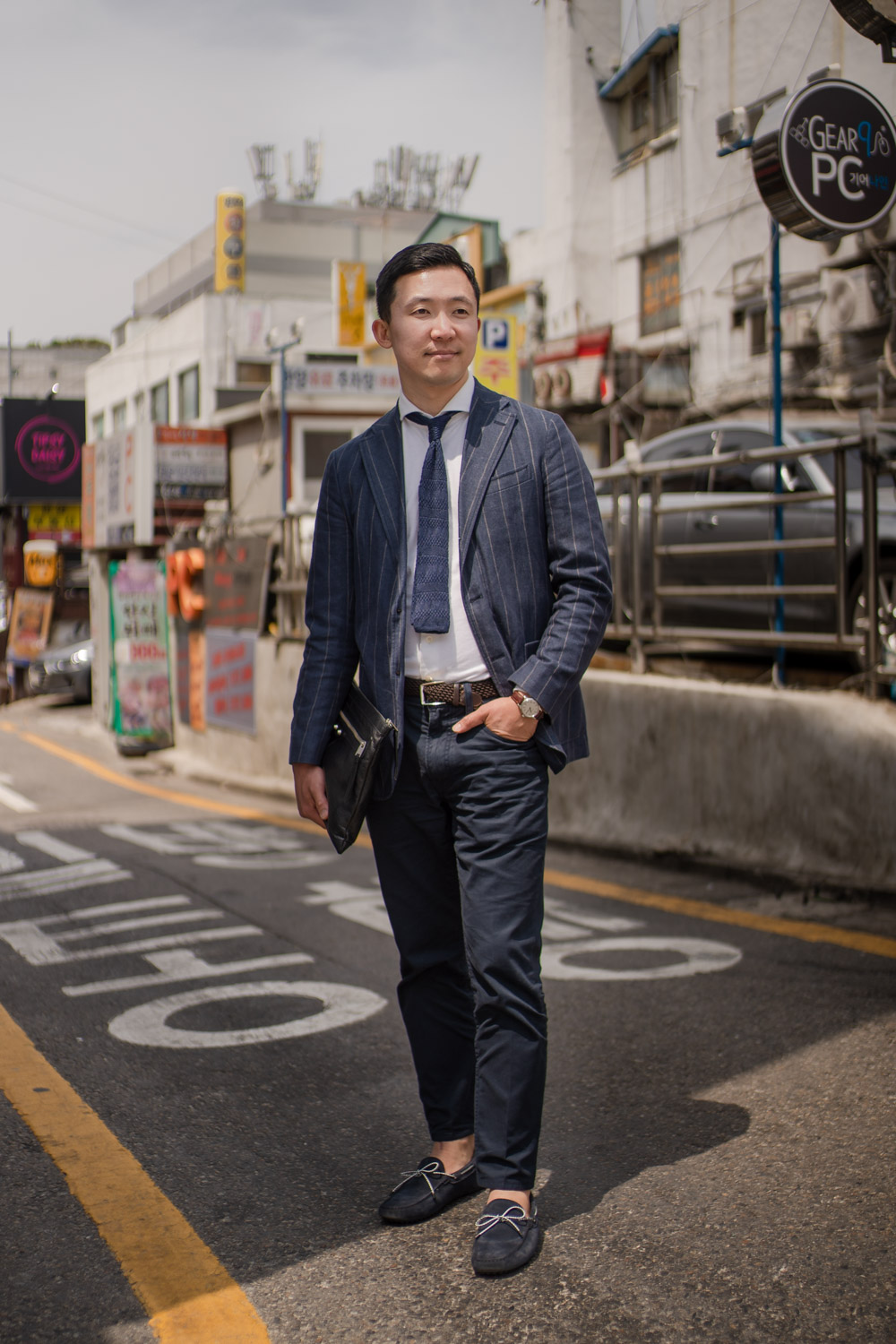 Pil-do Kim wearing a Jaeger-LeCoultre and posing in the backstreets of the Cheongdam district of Seoul. Tim Franco for the New York Times