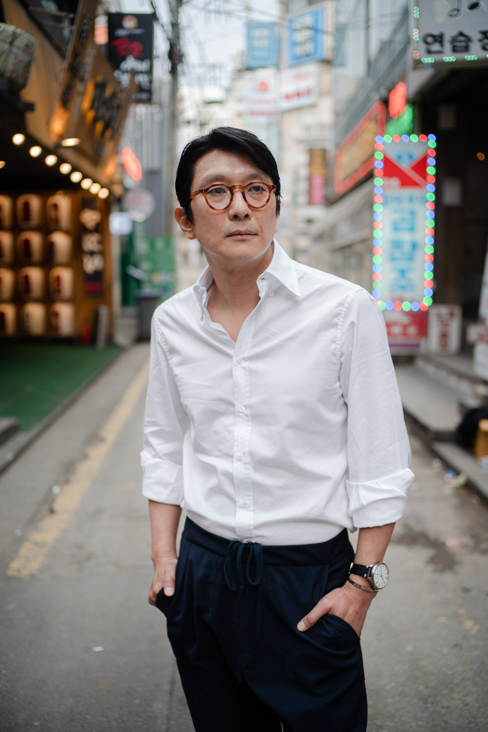 Montana Young-hoon Choi wearing a Système Glashütte and posing in the back streets of the Gangnam district of Seoul. Tim Franco for the New York Times.
