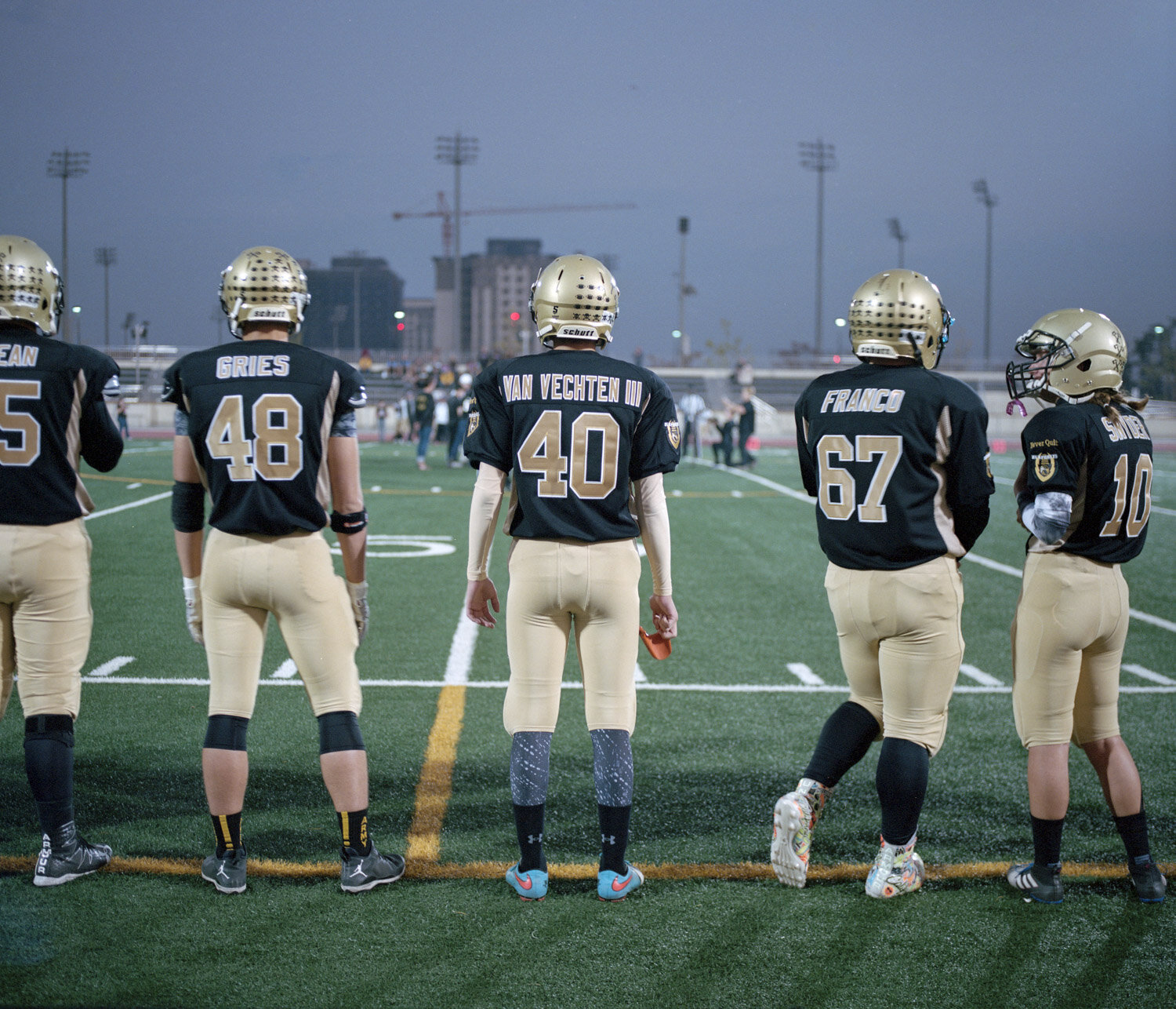 Football players from the Camp Humphrey Highschool on the sideline during a game inside the biggest American Base in South Korea.
