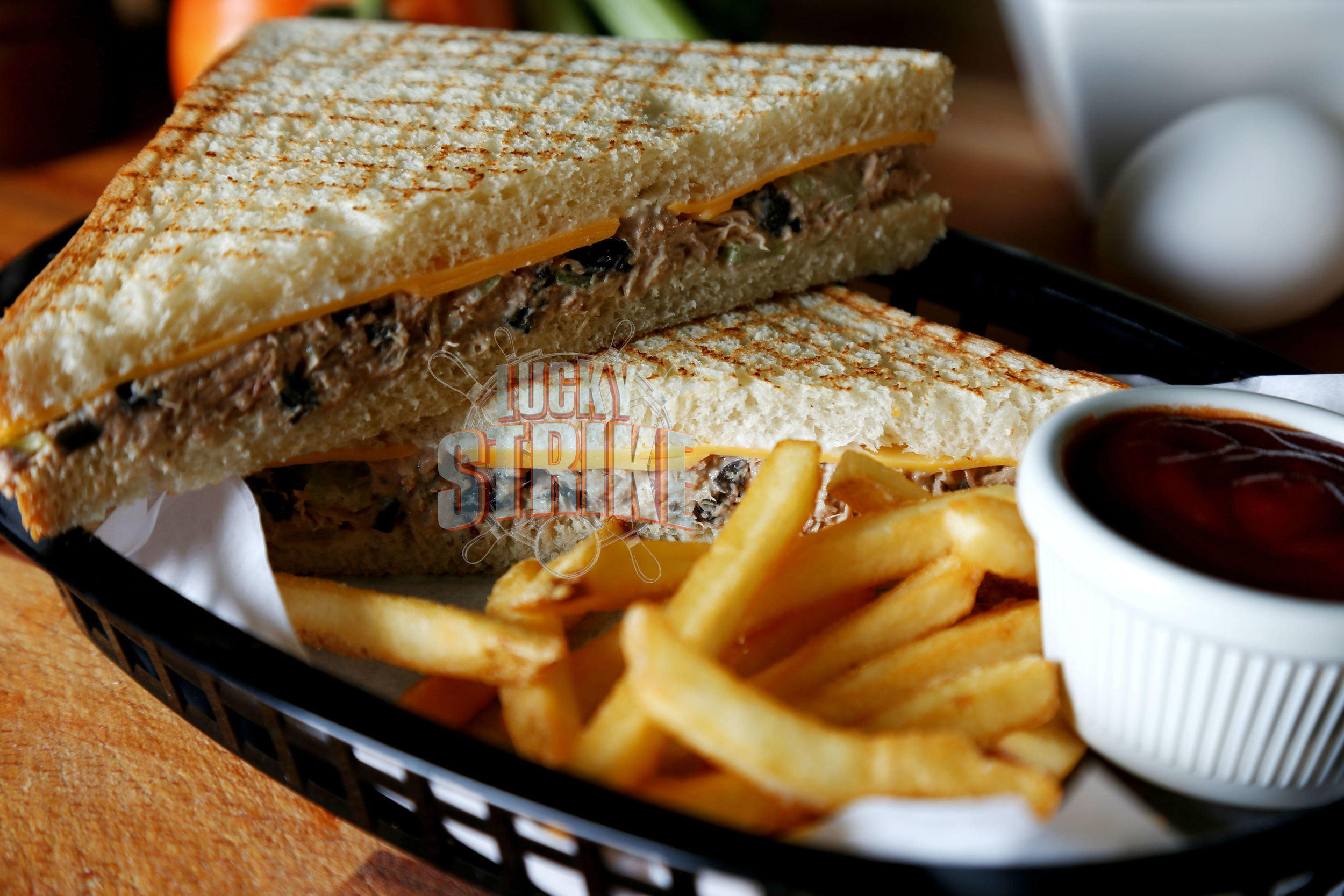 TUNA MELT SANDWICH                                             25   A healthy mix of tuna, spring onion cheddar cheese, mayo in toasted bread served with french fries