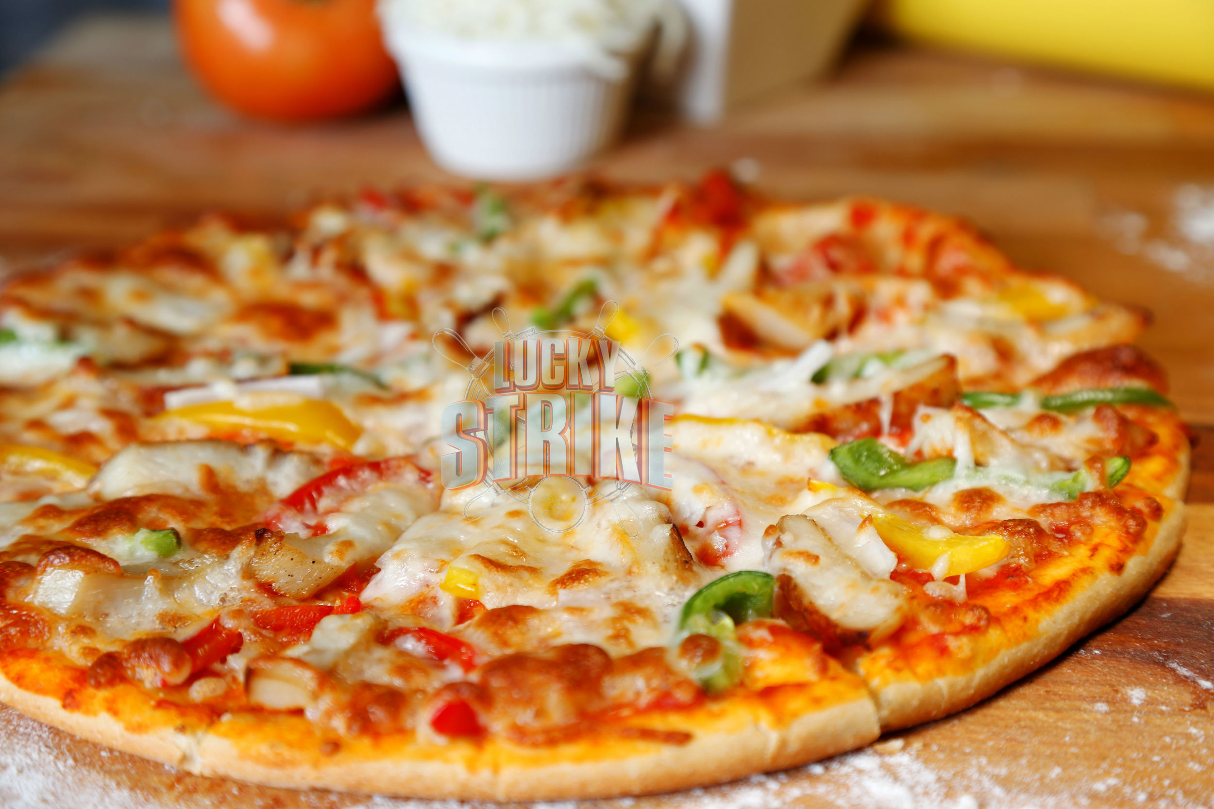 CHICKEN PIZZA                                                         38/49    Freshly homemade dough topped with grilled chicken & marinated with red, green, yellow capsicum, melted mozzarella cheese & Italian sauce